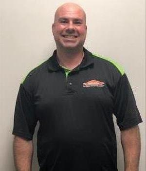 SERVPRO employee with black and green shirt