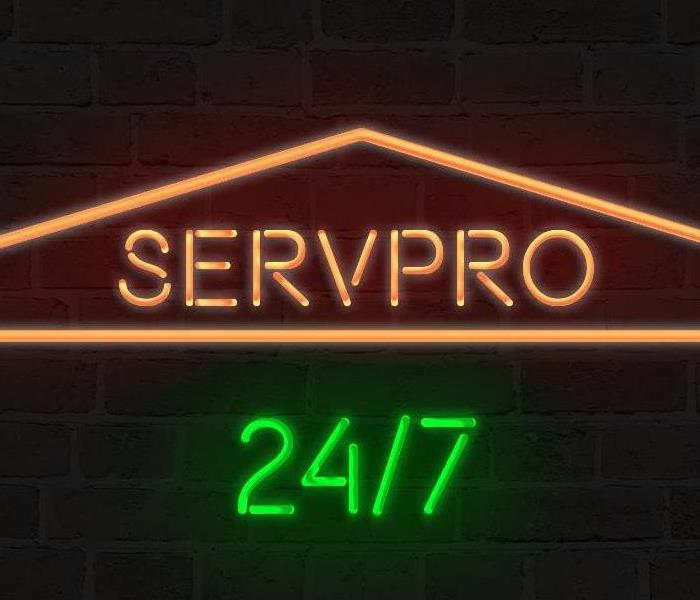 green and orange SERVPRO sign
